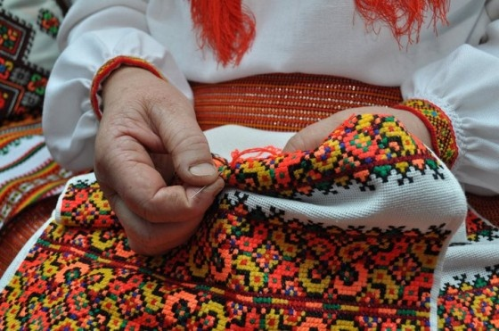 Paraska Yuryak is embroidering a rushnyk .